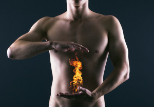 Pain in the abdomen or in the stomach of man. Heartburn.